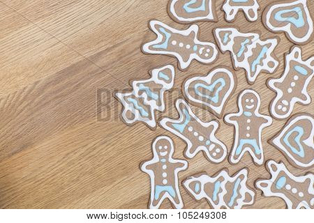 Variety of gingerbread cookies on a wooden background
