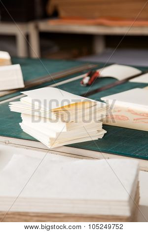 Closeup of stacked papers on table in factory