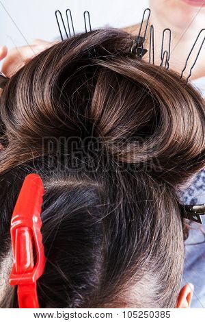 girl doing her hair in a beauty salon