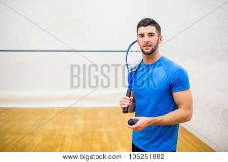 Man eager to play some squash in the squash court