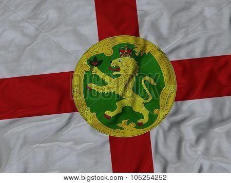 Closeup of ruffled Alderney flag