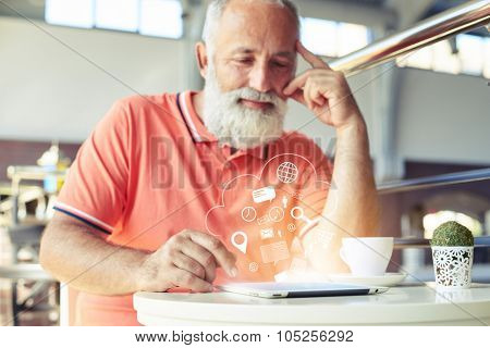 bearded senior man using tablet pc in cafe. virtual icons floating in the air