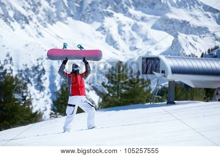 Happy snowboarder with snowboard, winter fun