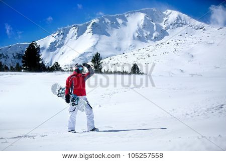 Snowboarder with snowboard, winter holiday