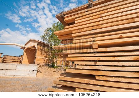 Wood planks stacked at lumber mill in Ontario, Canada