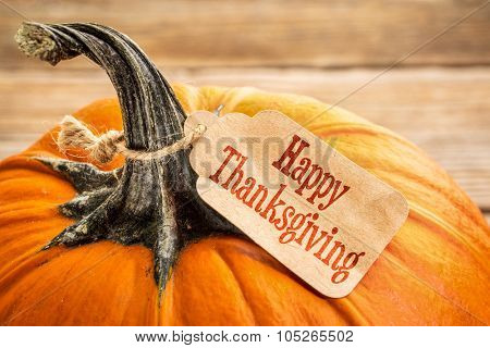 pumpkin with a Happy Thanksgiving paper price tag -  holiday shopping concept