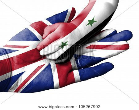 Adult Man Holding A Baby Hand With United Kingdom And Syria Flags Overlaid. Isolated On White
