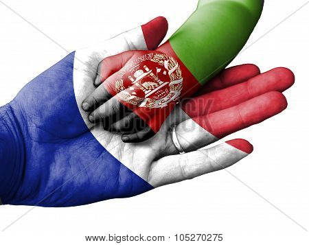 Adult Man Holding A Baby Hand With France And Afghanistan Flags Overlaid. Isolated On White