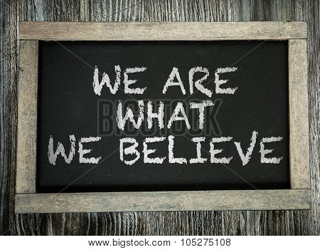 We Are What We Believe written on chalkboard
