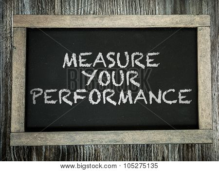 Measure Your Performance written on chalkboard