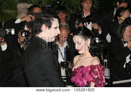 CANNES, FRANCE - MAY 21: Dita Von Teese and Marilyn Manson attend the 'Over The Hedge' premiere at the Palais Des Festivals during the 59th  Cannes Film Festival May 21, 2006 Cannes, Franc