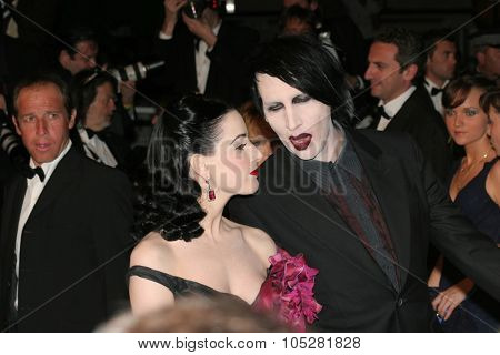 CANNES, FRANCE - MAY 21: Dita Von Teese and Marilyn Manson attend the 'Over The Hedge' premiere at the Palais Des Festivals during the 59th  Cannes Film Festival May 21, 2006 in Cannes, France