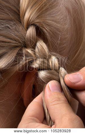 Hands Weaving Braid