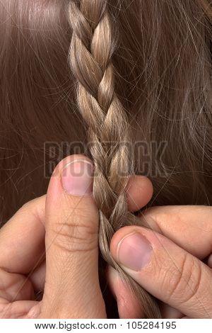 Hands Of Hairdresser Weaving Braid, Closeup