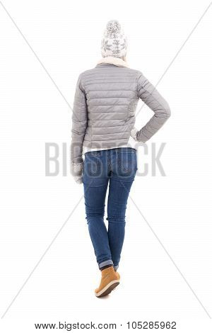 Back View Of Woman In Winter Clothes Isolated On White