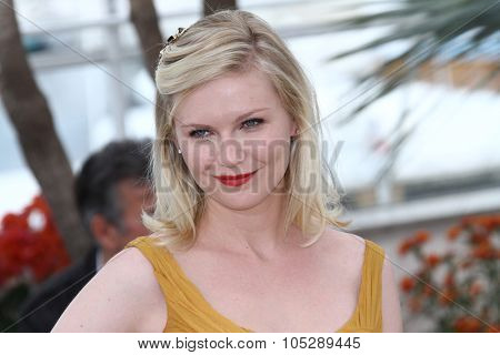 CANNES, FRANCE - MAY 18: Kirsten Dunst  attends the 'Melancholia' photocall at the Palais des Festivals during the 64th Cannes Film Festival on May 18, 2011 in Cannes, France