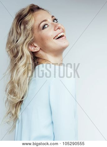 young pretty blond woman smiling on white background close up makeup