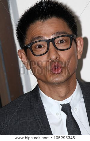 VENICE, ITALY - SEPTEMBER 05: Actor Andy Lau  poses at the 'Tao Jie' photocall during the 68th Venice Film Festival at Palazzo del Cinema on September 5, 2011 in Venice, Italy