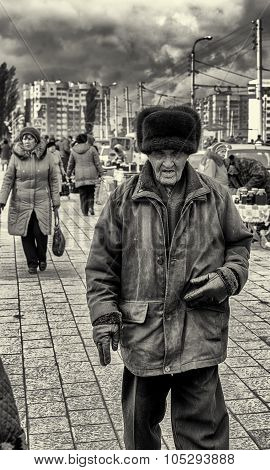 Old Russian Man Wearing A Ushanka And The Windy Storm