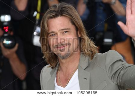 CANNES, FRANCE - MAY 22: Brad Pitt poses at the 'Killing Them Softly' photocall during the 65th Annual Cannes Film Festival at Palais des Festivals on May 22, 2012 in Cannes, France.