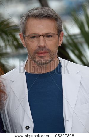 CANNES, FRANCE - MAY 21: Lambert Wilson poses at 'Vous N'avez Encore Rien Vu' Photocall during the 65th Annual Cannes Film Festival at Palais des Festivals on May 21, 2012 in Cannes, France.