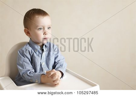 baby businessman at a business luncheon