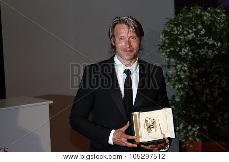CANNES, FRANCE - MAY 27: Mads Mikkelsen poses with his Best Actor Award for his role in 'The Hunt' at the Winners Photocall during the 65th  Cannes Film Festival on May 27, 2012 in Cannes, France.
