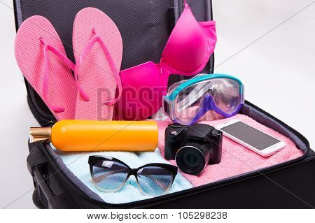 Tourism Concept - Close Up Of Packed Suitcase Full Of Travel Items