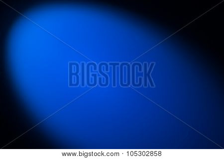 Black and blue background lighted with snoot