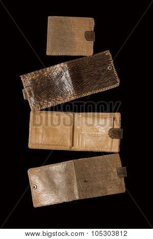 Open And Closed Purse Of Snake Skin On A Black Background