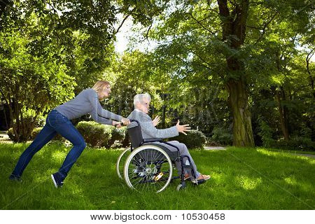 Woman Having Difficulties Pushing A Wheelchair