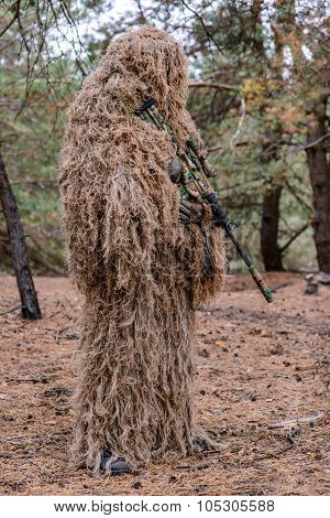 Sniper In Camouflage Suit With Rifle In Hands