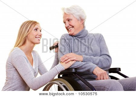 Day Care For Elderly Woman In Wheelchair
