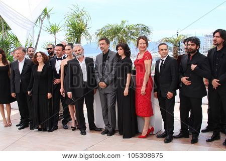 CANNES, FRANCE - MAY 16: Nuri Bilge Ceylan, actors Melisa Soezen, Demet Akbag and Haluk Bilginer attends the 'Winter Sleep' photocall at the 67th  Cannes  Festival on May 16, 2014 in Cannes, France.
