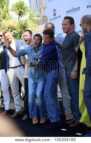 CANNES, FRANCE - MAY 18: Sylvester Stallone,Antonio Banderas  attend a photocall for 'The Expendables 3' at the Carlton Hotel on May 18, 2014 in Cannes, France.