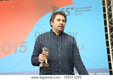 BERLIN, GERMANY - FEBRUARY 14: Radu Jude poses the best director at the press conference during the 65th Berlinale Festival at Hyatt Hotel on February 14, 2015 in Berlin, Germany.