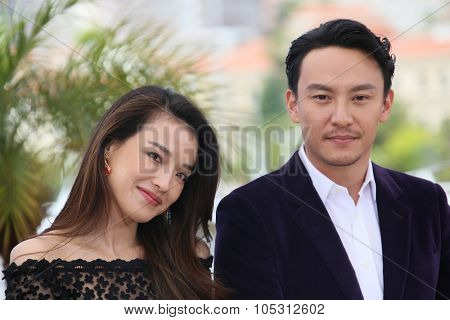 Shu Qi,Clemens Bilan attend a photocall for 'Nie Yinniang' during the 68th annual Cannes Film Festival on May 21, 2015 in Cannes, France.
