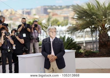 Greek director Costa-Gavras attends the Invite D'Honneur photocall during the 68th annual Cannes Film Festival on May 18, 2015 in Cannes, France.