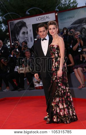 Johnny Depp and Amber Heard  attend a premiere for 'A Danish Girl' during the 72nd Venice Film Festival at on September 5, 2015 in Venice, Italy.