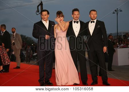 Johnny Depp and Dakota Johnson,  director Scott Cooper and Joel Edgerton attend the premiere of the movie 'BLACK MASS' during the 72nd Venice Film Festival on September 4, 2015 in Venice, Italy.