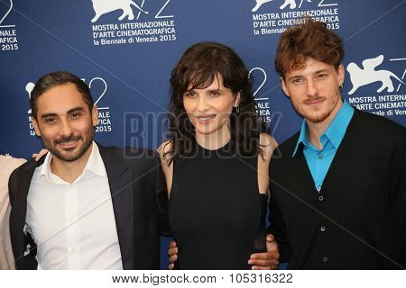 Actress Juliette Binoche, Piero Messina attend a photocall for 'The Wait' during the 72nd Venice Film Festival at Palazzo del Casino on September 5, 2015 in Venice, Italy.