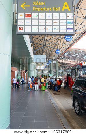 HANOI, VIETNAM - MAY 11, 2015: Noi Bai International Airport departure bus stop. Noi Bai International Airport is the largest airport in Vietnam. It is the main airport serving Hanoi