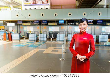 HANOI, VIETNAM - MAY 11, 2015: full size photo banner of crew member in Noi Bai International Airport. Noi Bai International Airport is the largest airport in Vietnam.
