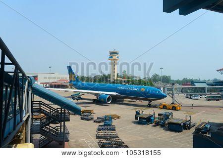 HANOI, VIETNAM - MAY 11, 2015: modern jet aircraft in Noi Bai International Airport. Noi Bai International Airport is the largest airport in Vietnam.