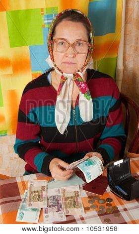 Sad Erderly Woman With Money