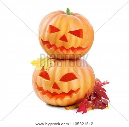 Halloween pumpkin head jack lantern with burning candles isolated on white background. Halloween holidays art design, celebration. Couple of Carved Halloween Pumpkins
