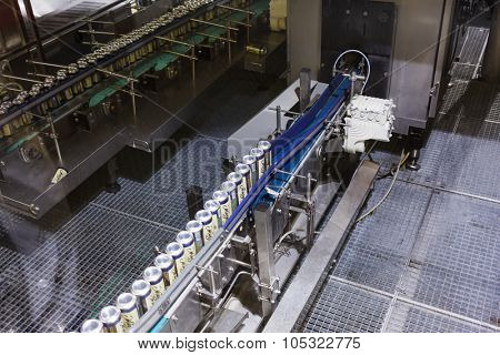 MOSCOW - DECEMBER 2, 2014: conveyor with beer cans closeup at Moscow Brewing Company