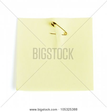 Yellow adhesive note attached with safety pin