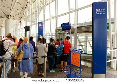 HONG KONG - MAY 13, 2014: people boarding on the flight in Hong Kong Airport. Hong Kong International Airport is the main airport in Hong Kong.