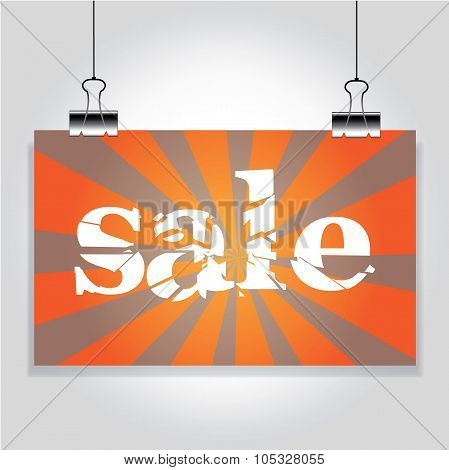Sale Sign Hanging On The Clamps